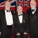 Frank speaking at a Help for Heroes event in Oswestry in 2013 (pictured in between 2 of his sons)