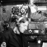 Leading Telegraphist (note arm badges) Eric Pountney on duty in the W/T Office on HMS Venomous