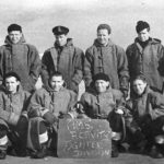 Group in front of the sign HMS Activity fighter division, taken in 1944 at the Kola Inlet, Murmansk. My father in law, Evan Roberts is back row, second from the left.