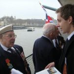 Gordon and Charles Downs chatting with the relatives of the veterans on board HMS Belfast in June 2012