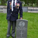 Gordon paying homage to his friend William Pert, buried at the military cemetery in Archangel, June 2012