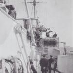 Leonard standing on the starboard quarterly deck