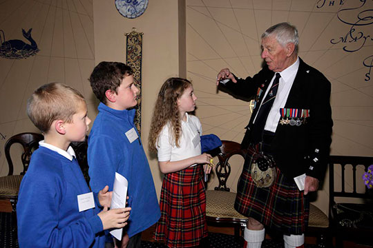 Veterans Jock Dempster and Jimmy McHugh talk to local school children in Poolewe