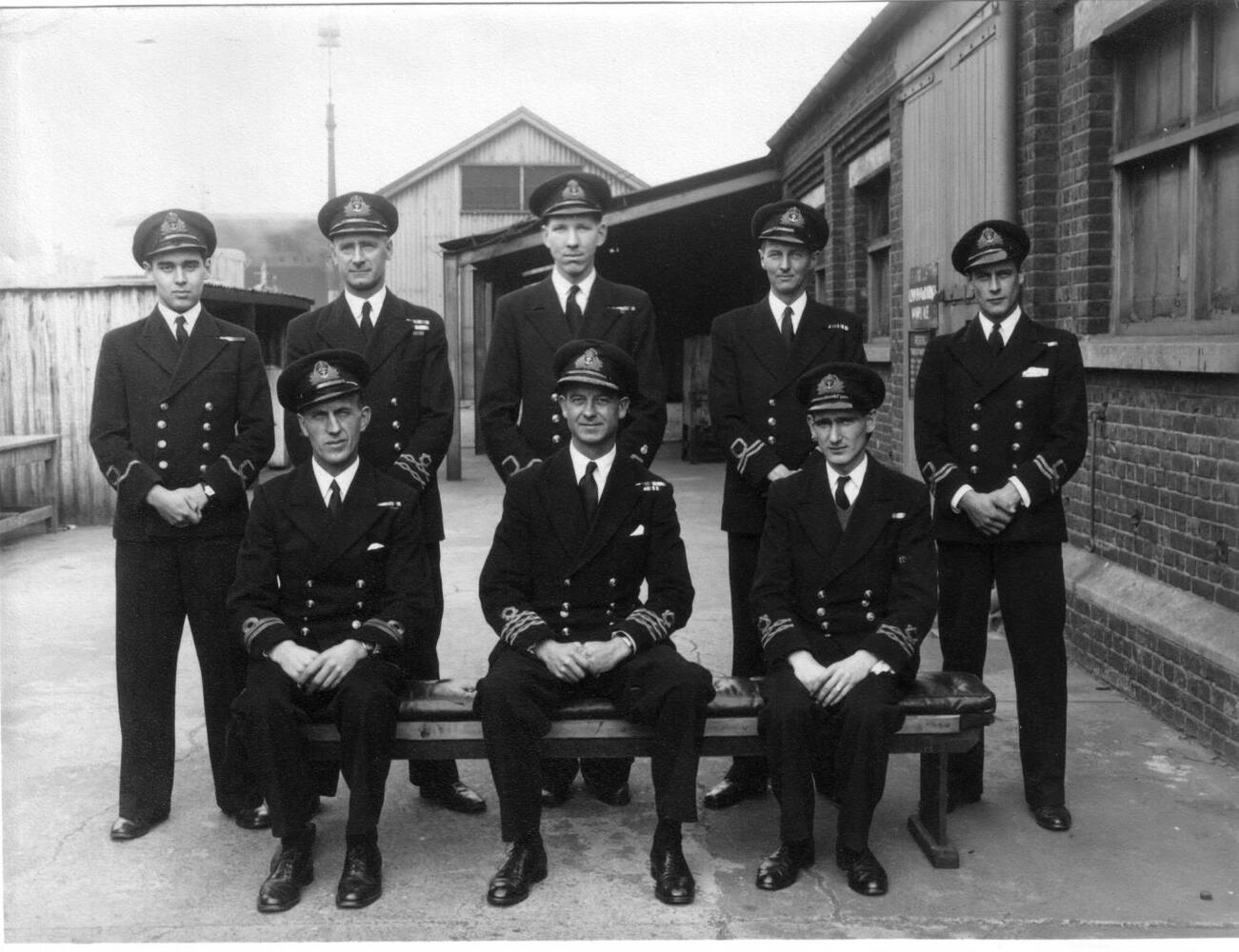 Latterly, Lieutenant A H Harvey seen centre back with officers from HMS Grecian.
