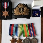 John McMurtrie's cap badge and medals